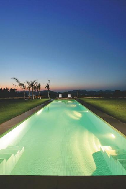 beautiful long pool What Does A $72.7 Million Luxury Property Look Like?
