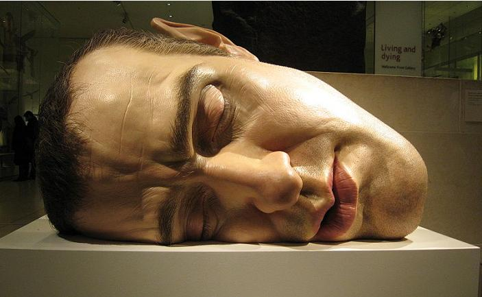 ron mueck face on side self portrait hyperrealistic Ever Seen a Sculpture with a Gigantic Head?