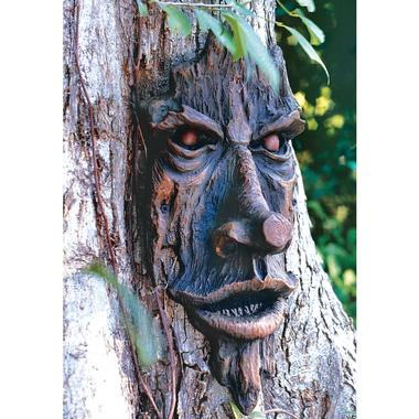 tree face sculpture lawn ornament 13 Utterly Ridiculous Lawn Ornaments