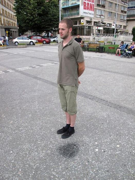 man looks like hes levitating optical illusion The Friday Shirk Report   February 5, 2010 | Volume 43