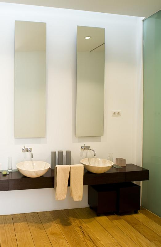 bathroom with tall long and skinny mirrors Mega Mansion in Madrid by A Cero