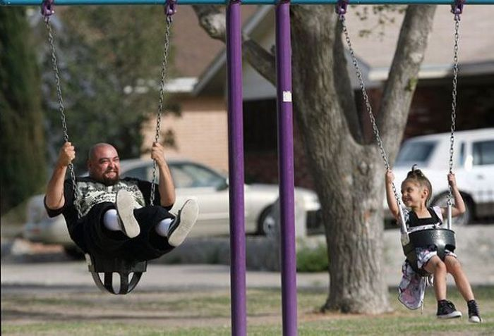 father thug gangster riding swing with daughter Picture of the Day   April 18, 2010