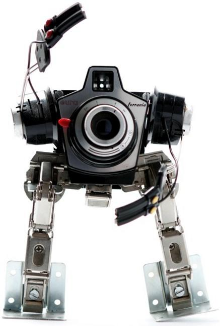 robotic sculpture made from camera Incredible Robot Sculptures Made from Old Electronic Parts