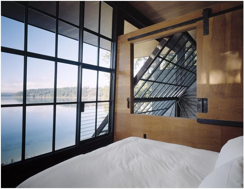 incredible view of lake from cabin Industrial Chic   Modern Cabin with Giant Window for a Wall