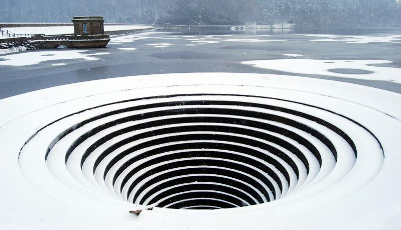 large hole in the water Bell Mouth Spillways: How Giant Holes in the Water are Possible