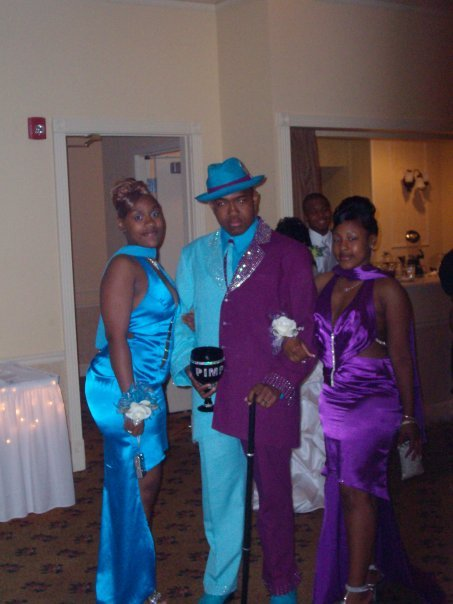 pimp-with-half-blue-half-purple-suit-and-two-women-and-chalice.jpg