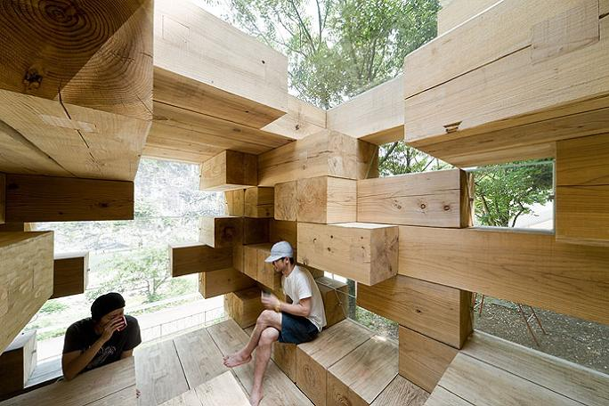 house made of wooden beams Remember Jenga? This is the House Version of It
