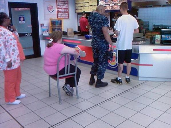 person sitting in line at burger king in chair The Friday Shirk Report   June 11, 2010 | Volume 61