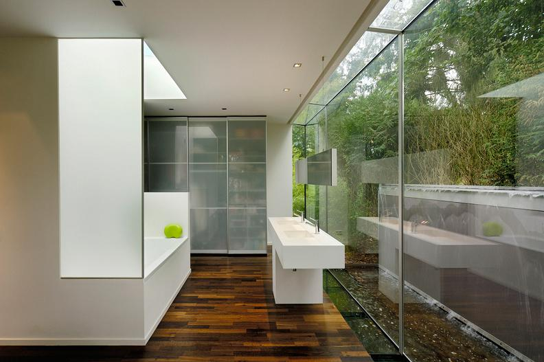 beautiful bathroom with wall to wall windows A Beautiful Bungalow Built Atop A Pond
