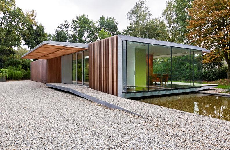 bungalow with water running underneath paul de ruiter A Beautiful Bungalow Built Atop A Pond