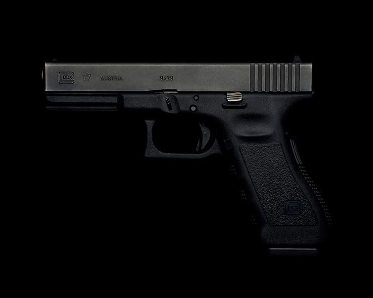glock-17-handgun-on-black-background