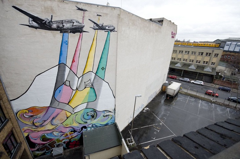 graffiti street art planes dropping love bombs Picture of the Day   August 4, 2010