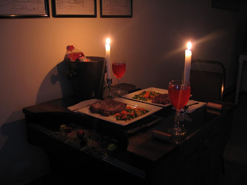 romantic candelight dinner on pacman table roll of quarters Picture of the Day   August 14, 2010
