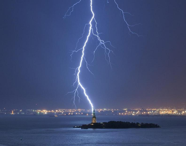 lightning bolt strikes statue of liberty Natures Fury: 30 Chilling Photos of Natural Hazards