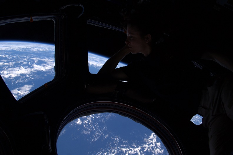 woman astronaut looking at earth from space Picture of the Day: Theres No Place Like Home | Nov 17, 2010