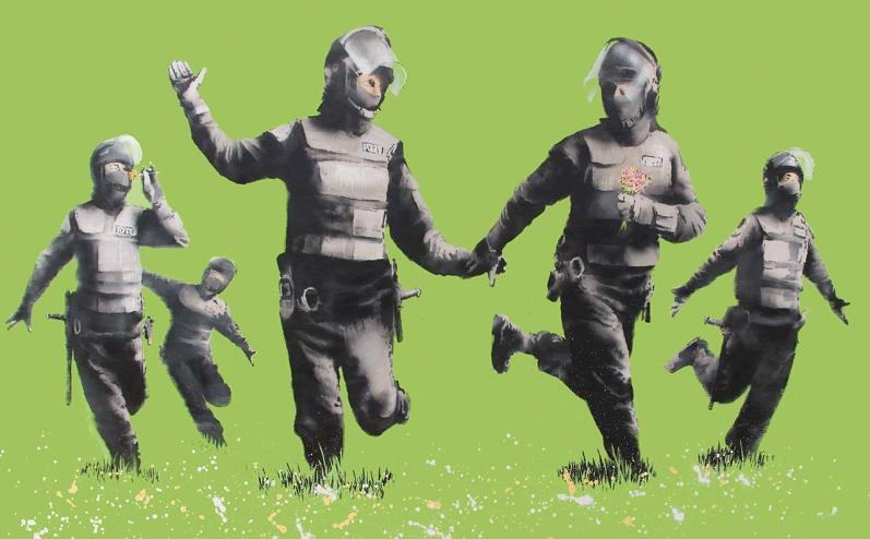 riot cops playing in field Picture of the Day: Banksys Green Riot Cops