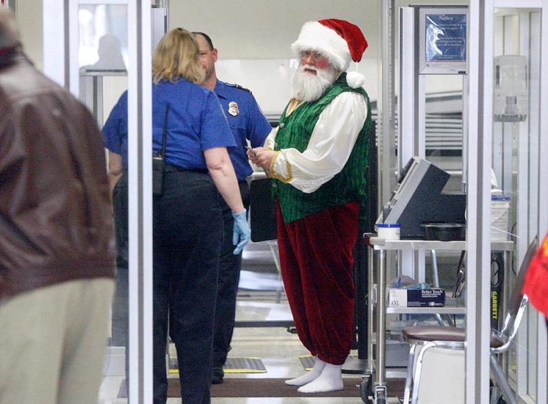 santa claus tsa screening Picture of the Day: Ho Ho Hold on Santa | Dec. 15, 2010