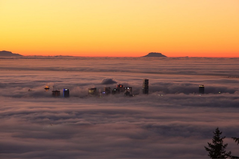 fog rolling over vancouver Picture of the Day: Fog Rolls Through Vancouver