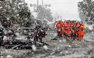 earthquake tsunami in japan snow falling Heavy snow falls on rubble and rescue workers at a devastated factory area hit by an earthquake and tsunami in Sendai, northern Japan
