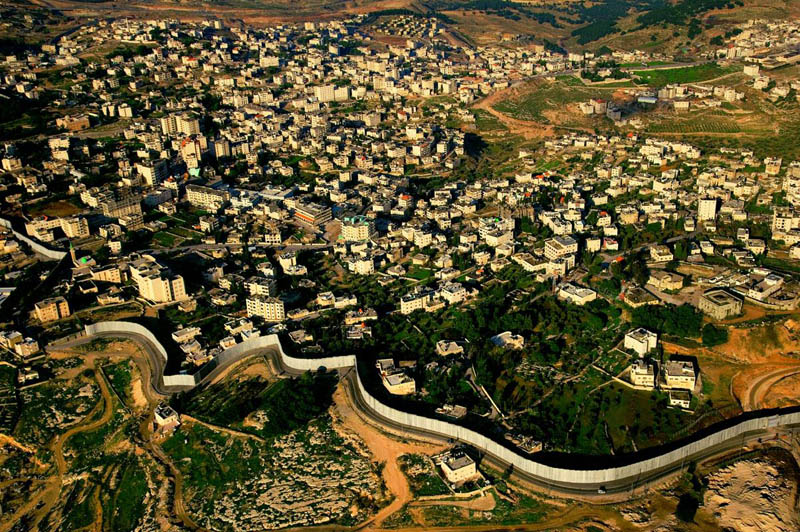 the separation wall built by israel in the west bank 25 Mind Blowing Aerial Photographs Around the World