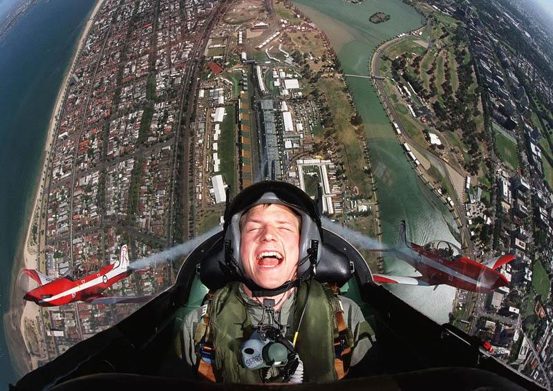 kimi raikkonen flying in plane over australian grand prix albert park The Top 50 Pictures of the Day for 2011