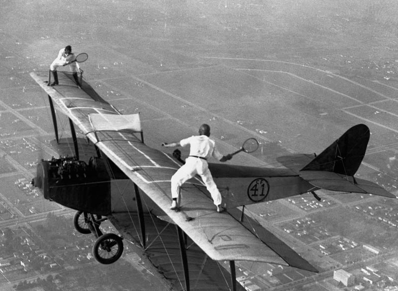 playing tennis on wings of plane vintage daredevils black and white The Top 50 Pictures of the Day for 2011
