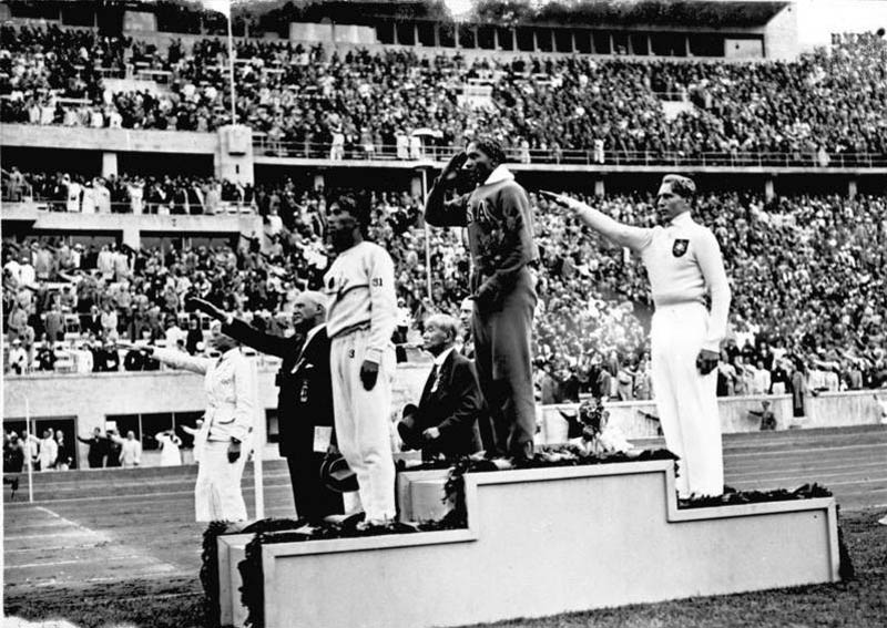 owens on podium 1936 olympics This Day In History   May 25th