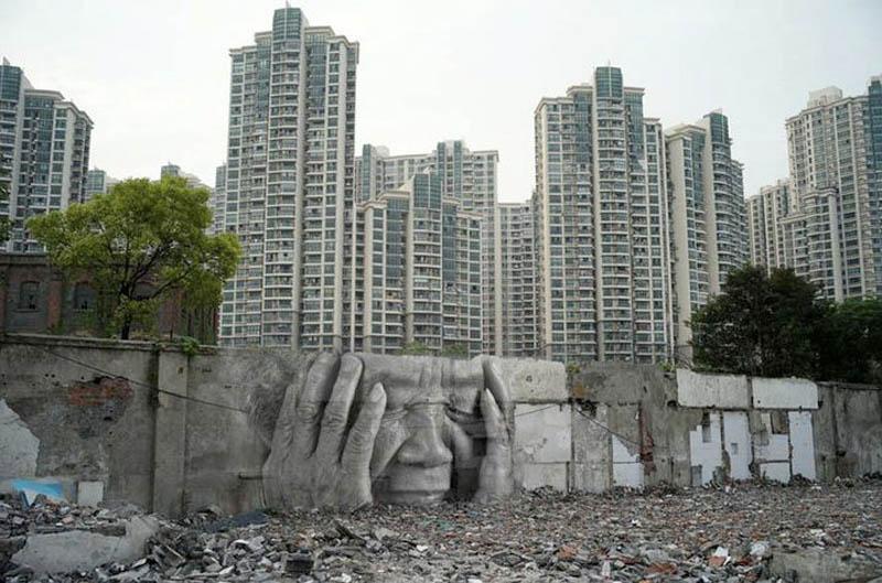 urban headache street art graffiti jr in front of aprtment complex1 Picture of the Day: Urban Headache