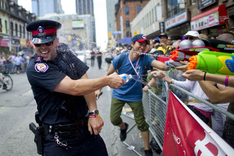 canadian toronto police officer water fight during pride 2011 carlos osorio Picture of the Day: Cops in Canada