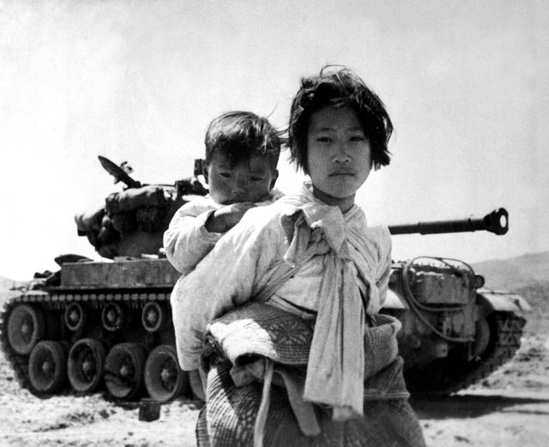 korean war children refugees in front of tank This Day In History   July 27th