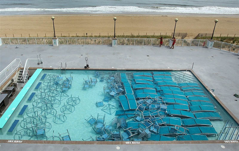 pool furniture at bottom of pool hurricane preparation Picture of the Day: Hurricane Irene Pool Preparations