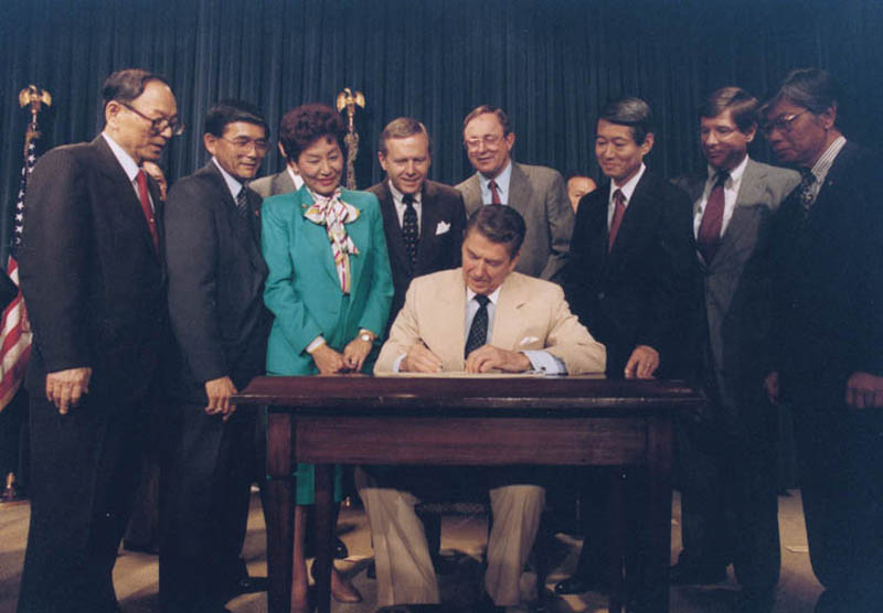 ronald reagan signing civil liberties act japanese reparations bill 1988 This Day In History   August 10th