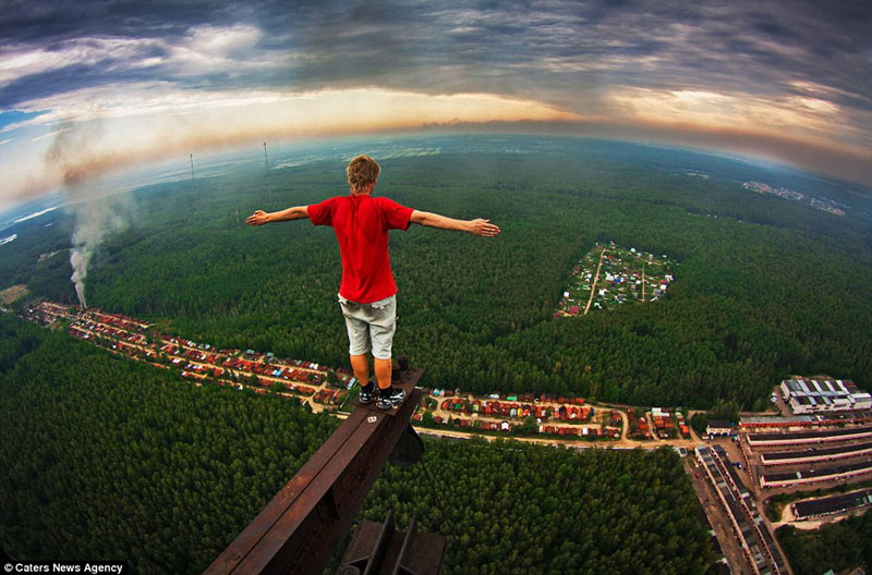 russian teenager marat dupri standing on high steel beam Picture of the Day: Watch Your Step