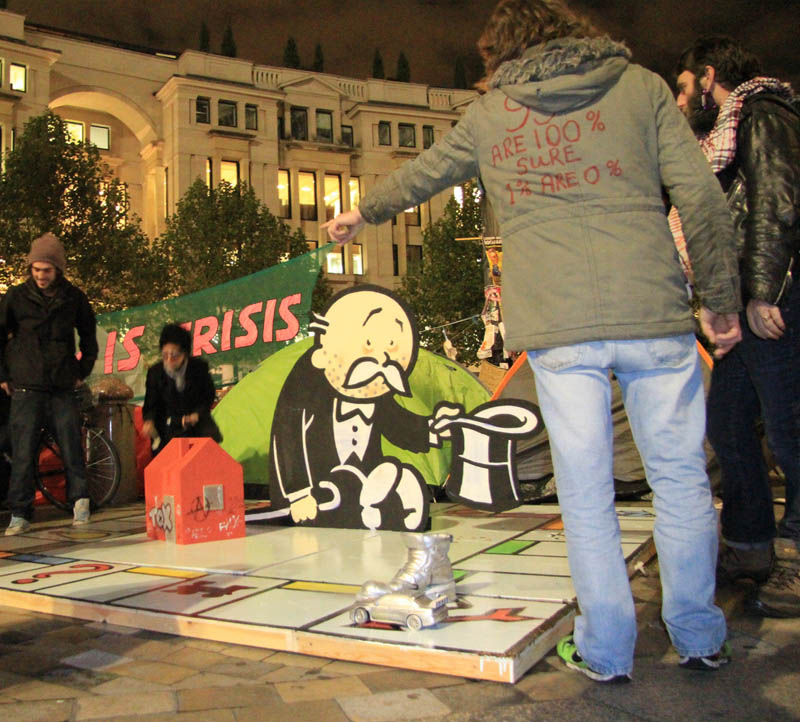 banksy occupy london lsx rich uncle frank pennybags begging Picture of the Day: Banksy Strikes Occupy London Protests