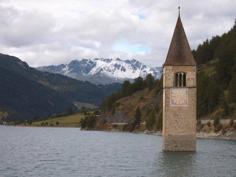 semi submerged clock tower of lake reschen Picture of the Day: The Submerged Clock Tower of Lake Reschen