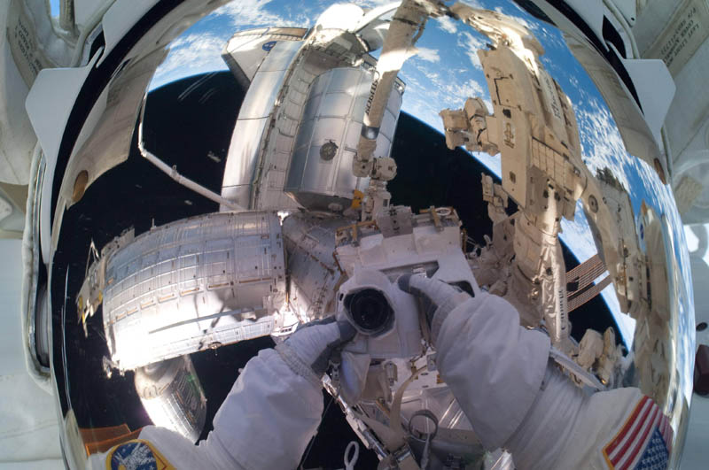 self portrait in space refelction of earth in helmet Picture of the Day: The Ultimate Self Portrait