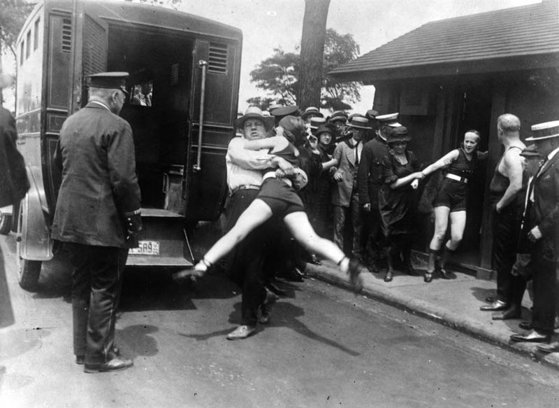 women being arrested for not wearing leg coverings on bathing suit 1922 chicago Picture of the Day: Bathing Suit Rebellion, Chicago 1922