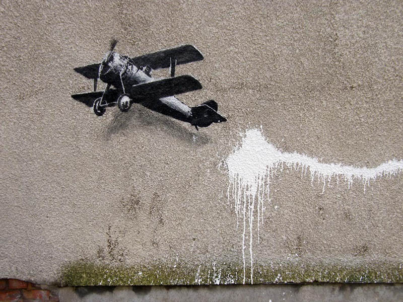 banksy plane stencil street art 1 Banksy Goes on a Holiday Tear [9 pics]