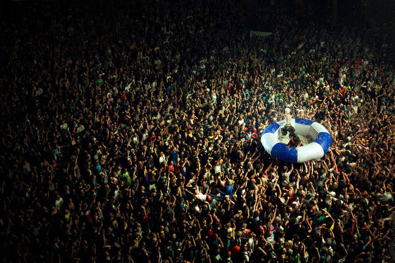 deichkind crowd surfing in huge inflatable raft Picture of the Day: Crowd Surfing Like a Boss