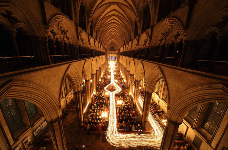 salisbury cathedral trail of candle lights long exposure Picture of the Day: Long Exposure Candle Trails at Salisbury Cathedral