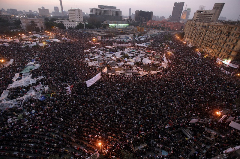 egyptian revolution praying mass tahrir square This Day In History   January 25th