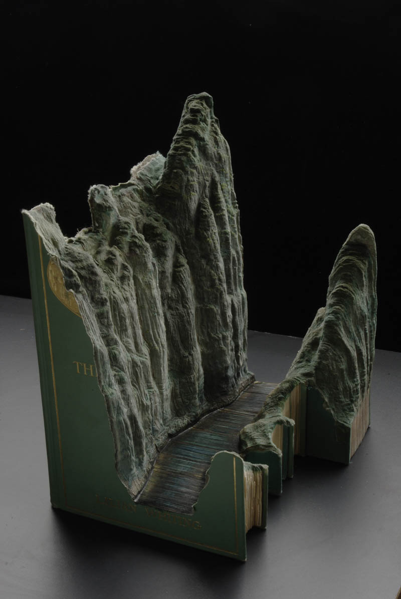 landscapes carved into books guy laramee 12 Incredible Landscapes Carved Into Books