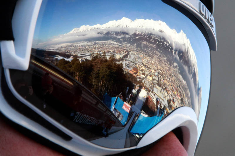 ski jump reflected in goggles Picture of the Day: The Art of Ski Jumping
