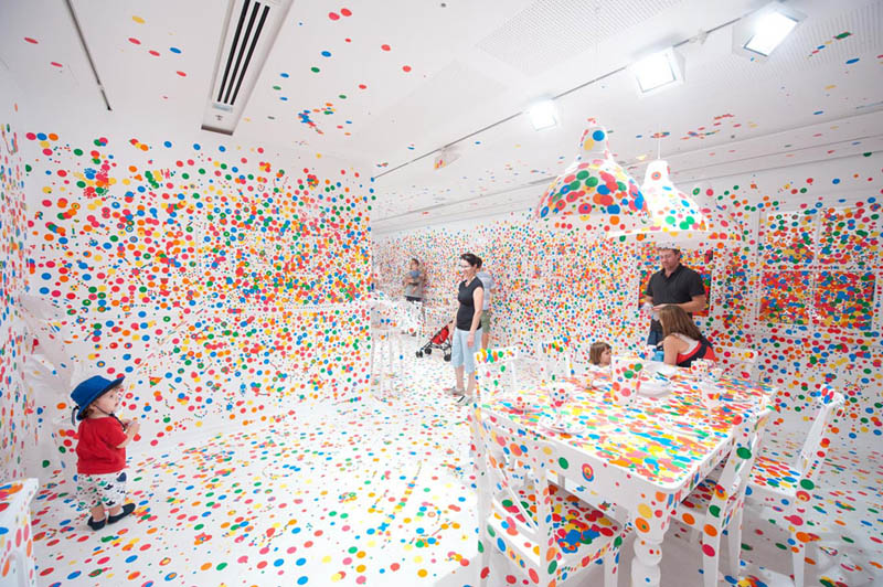 white room covered in stickers by kids yayoi kusama obliteration room 10 How To Climb a 3 Story House Without Leaving the Ground