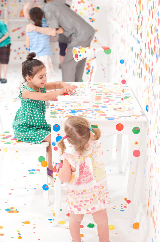 white room covered in stickers by kids yayoi kusama obliteration room 6 Kids Turn White Room into Explosion of Color