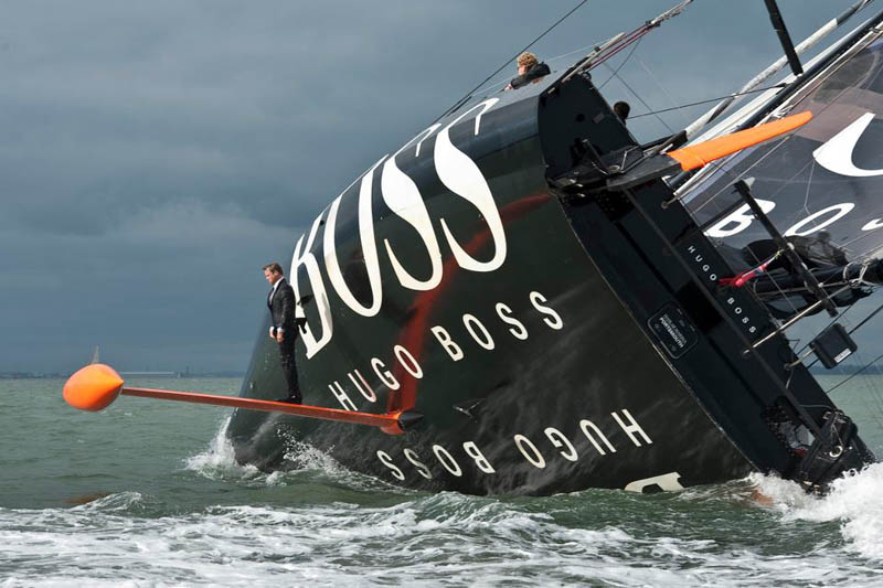 keel walk hugo boss suit boat sailing standing on rutter Picture of the Day: The Keel Walk