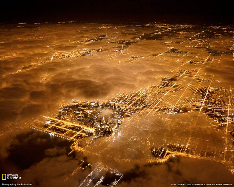 chicago lights at night aerial above the clouds Picture of the Day: Chicago City Lights at Night