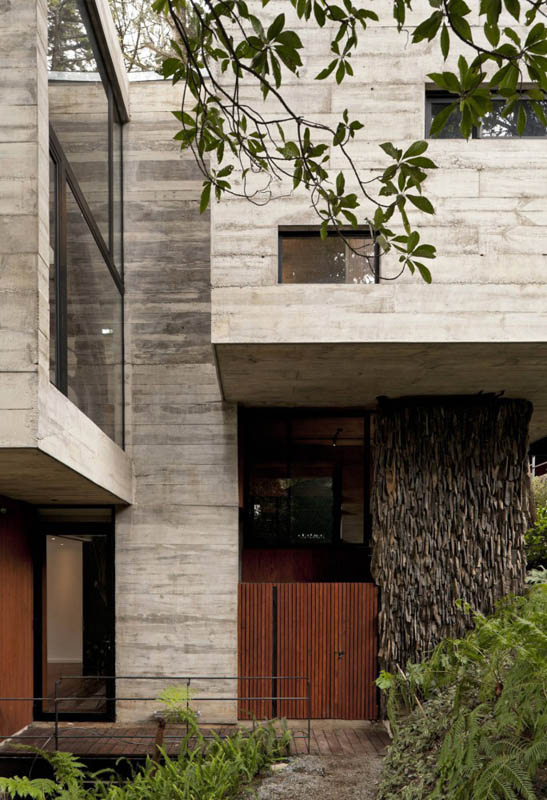 house in forest with trees growing through it 12 An Incredible Home in the Forest With Trees Growing Through It