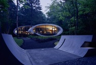 An Oval-Shaped Villa in the Forests of Japan