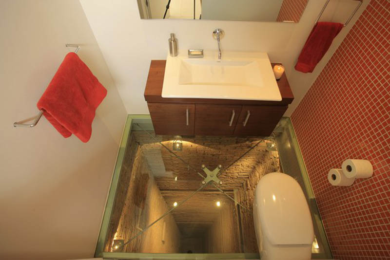 bathroom built over elevator shaft 3 This Bathroom Will Scare the Crap out of You